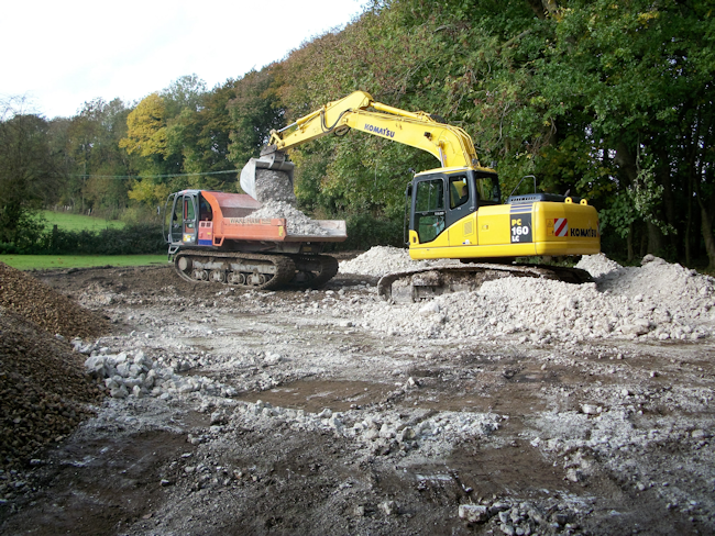 Komatsu excavating farm land