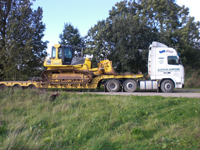 Low loader delivering plant hire